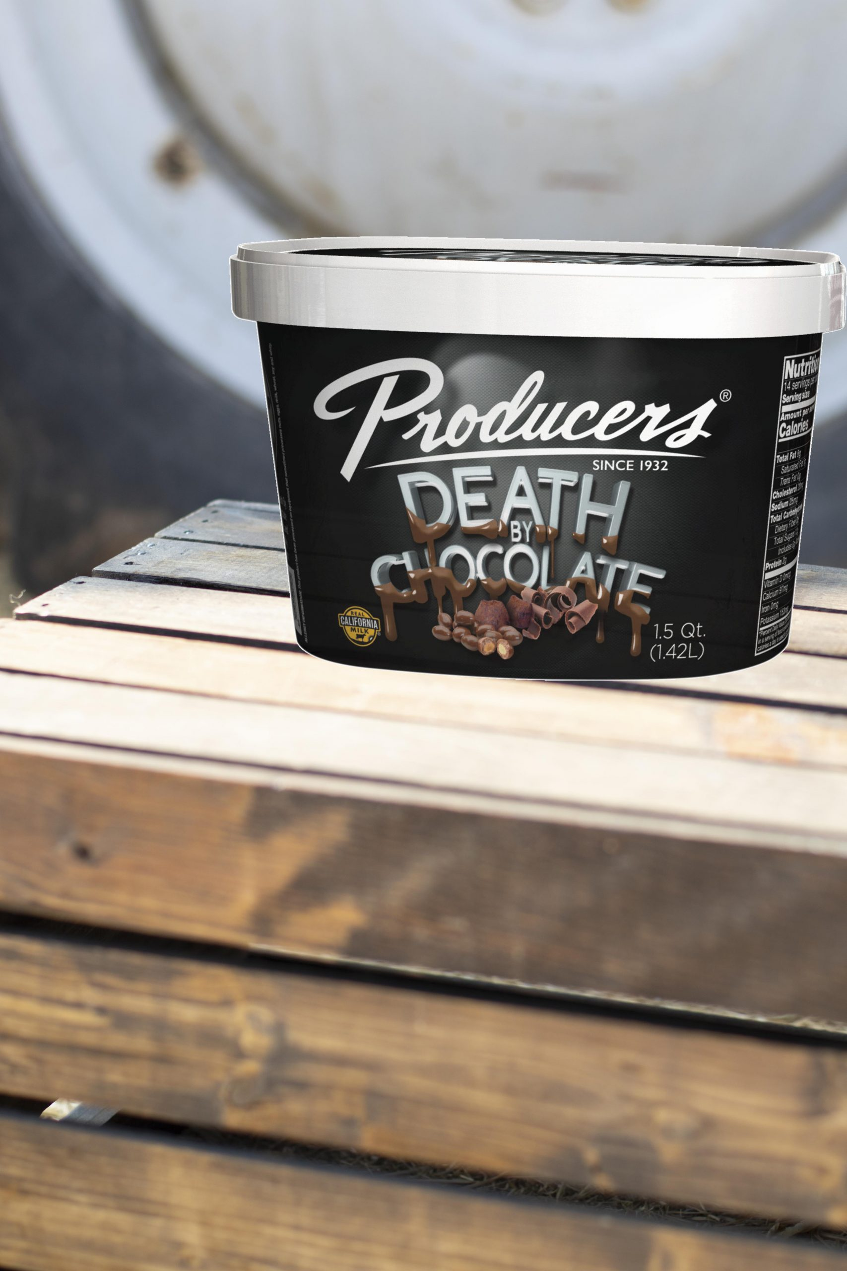 Death By Chocolate Producers Ice Cream sitting on wood in front of a tractor.
