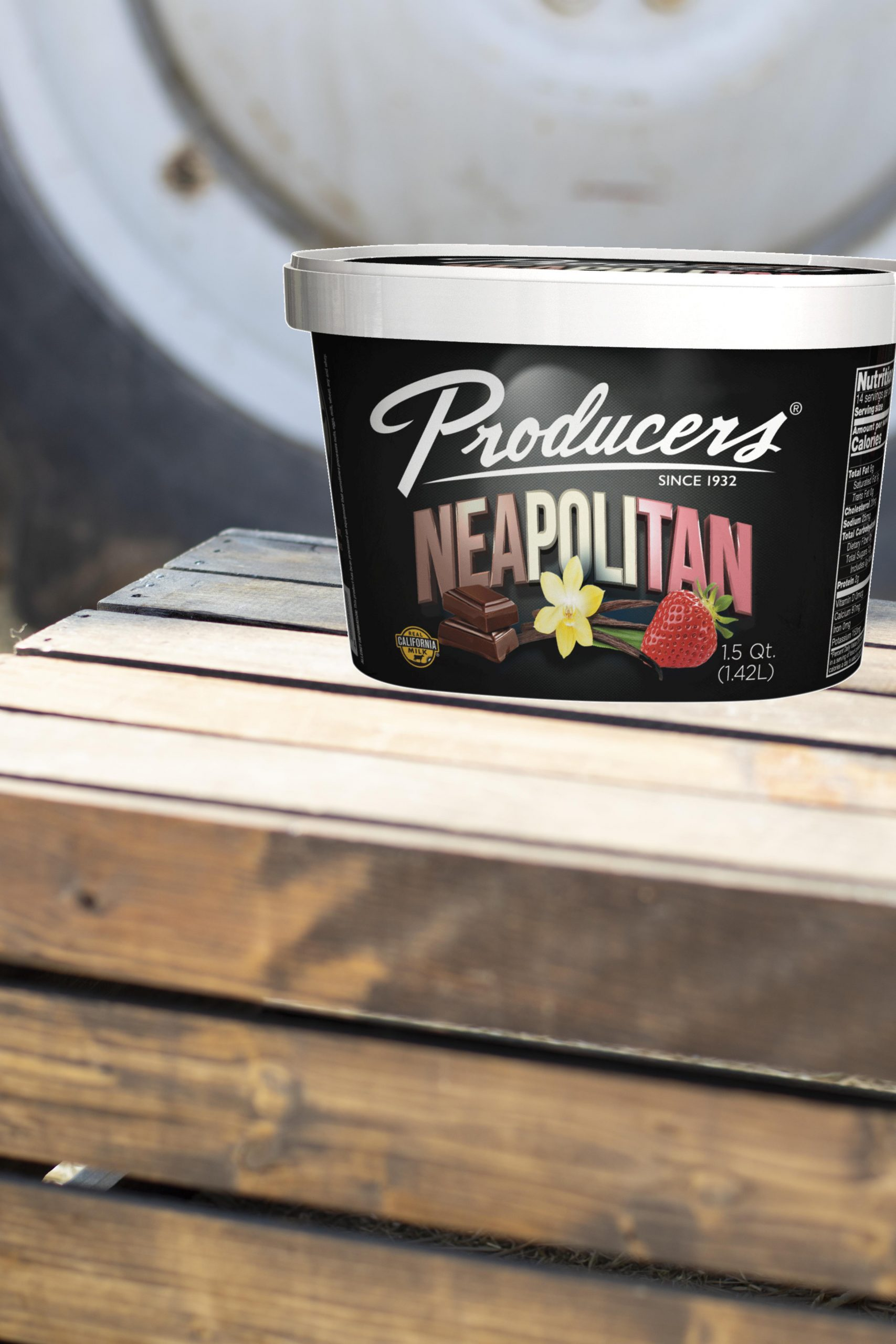 Neapolitan Producers Ice Cream sitting on wood in front of a tractor.
