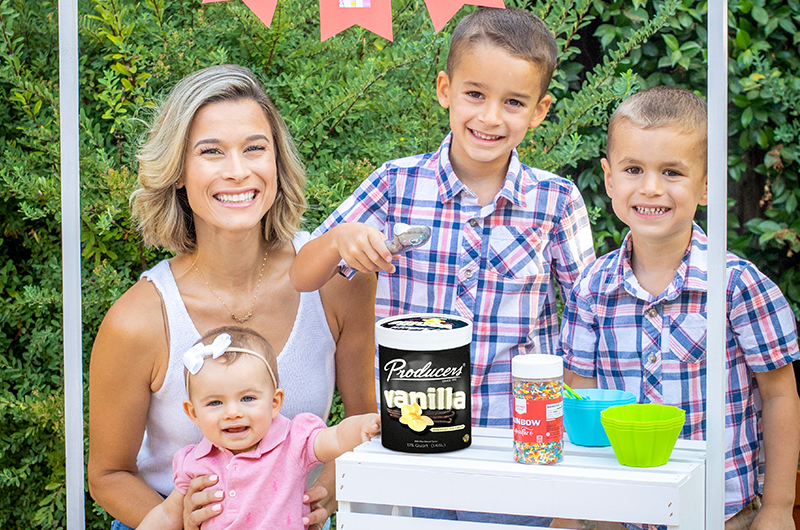Producers Influencer with her 3 kids scooping Producers Vanilla Ice Cream at a kid's ice cream stand.