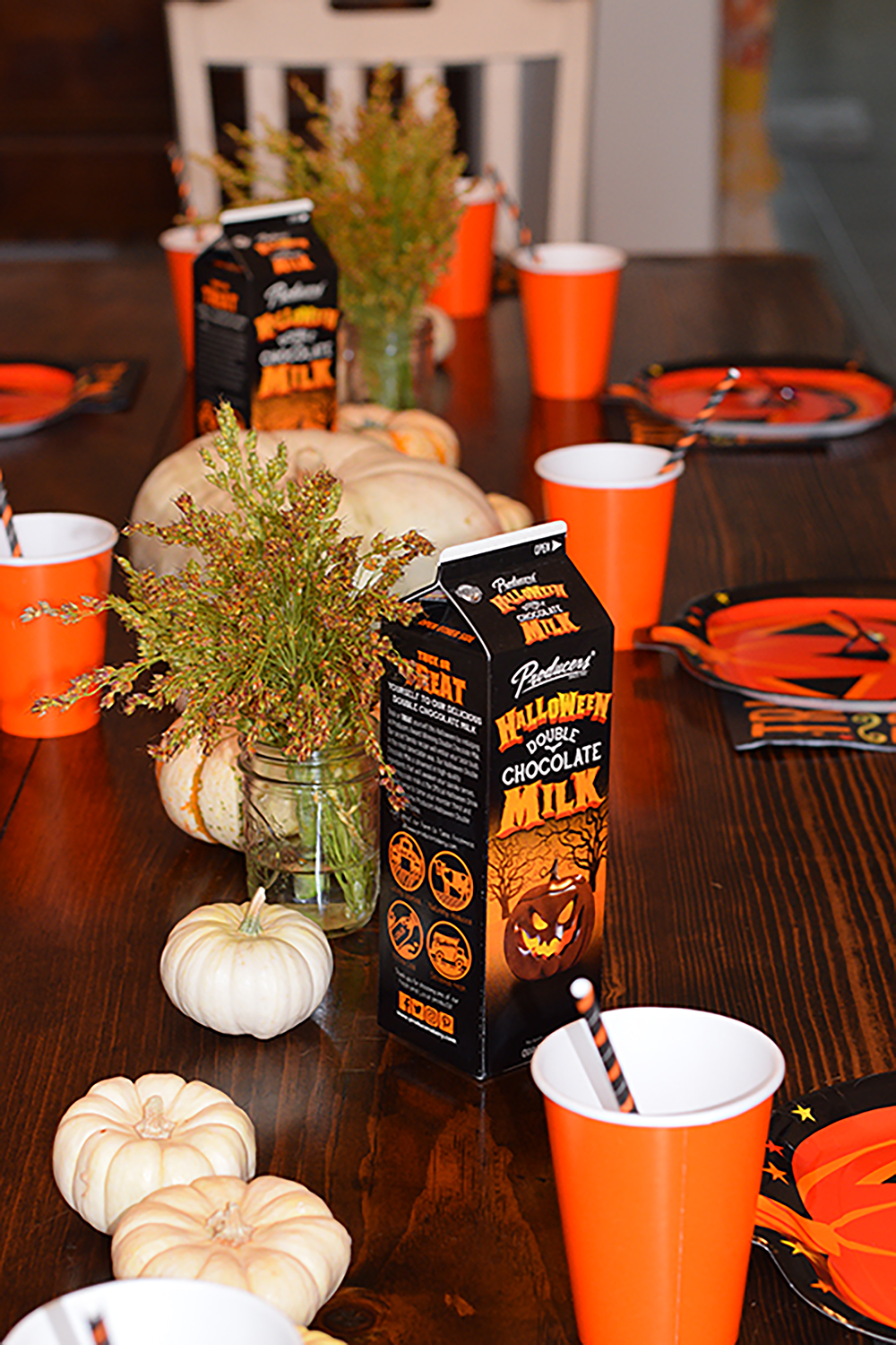Halloween Double Chocolate Milk on a halloween decorated table.