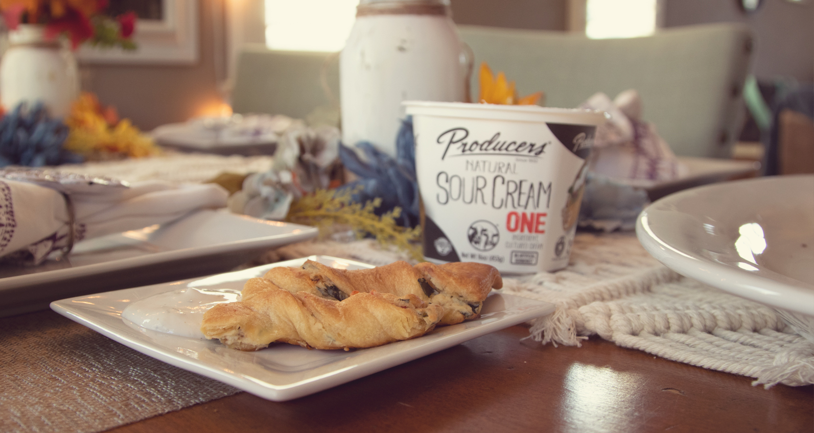 Holiday Breadsticks with Producers Natural Sour Cream on a decorated table.