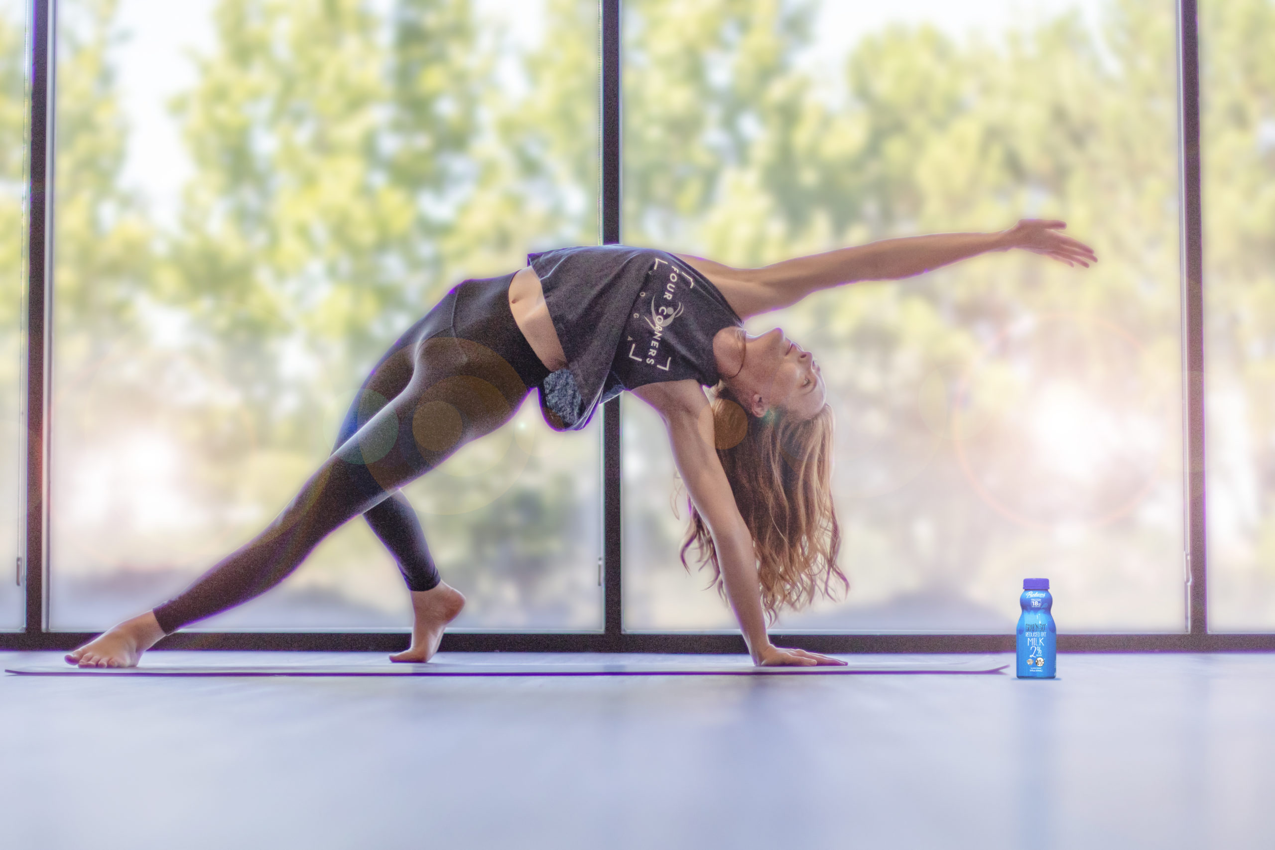 Girl doing yoga in front of a huge window with reduced fat grab n go.